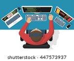 programmer at computer desk...   Shutterstock .eps vector #447573937