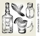 glass and bottle of tequila.... | Shutterstock .eps vector #447640573