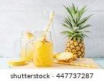 pineapple slices and juice in... | Shutterstock . vector #447737287