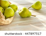 green pears in a paper bag on a ... | Shutterstock . vector #447897517