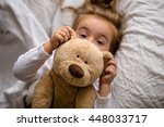 little girl in bed with soft... | Shutterstock . vector #448033717