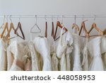 wedding dress on hangers in shop | Shutterstock . vector #448058953