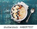 bowl of oatmeal porridge with... | Shutterstock . vector #448097557