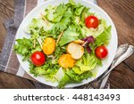 mixed salad in white bowl.... | Shutterstock . vector #448143493