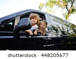 children look out from a car... | Shutterstock . vector #448205677