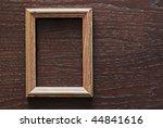 Blank Frame On Wooden Background