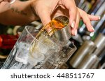 whiskey shot being poured  | Shutterstock . vector #448511767