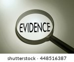 Small photo of Magnifying glass with the word evidence