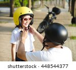 father trying to wear a bike... | Shutterstock . vector #448544377