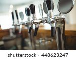 row of chrome beer taps at cafe | Shutterstock . vector #448623247