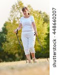 senior woman during nordic walk ... | Shutterstock . vector #448660207
