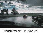drive car in rain on curve... | Shutterstock . vector #448965097