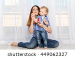 young mother and small daughter ... | Shutterstock . vector #449062327