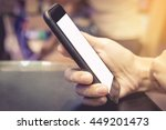 hand holding smart phone in... | Shutterstock . vector #449201473