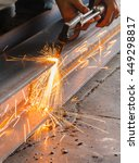 Small photo of Metal cutter, steel cutting with acetylene torch, industrial worker on manufacturing area.