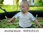 Cute Toddler Sitting In A...