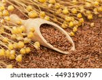 Linen Seeds In Wooden Spoon An...