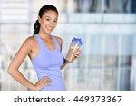 woman enjoying a protein shake... | Shutterstock . vector #449373367