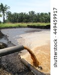 Small photo of Palm Oil Mill Effluent (POME) wastewater being discharged