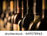 row of vintage wine bottles in...