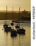 Small photo of View of Amble Harbour and Warkworth Castle at sunset
