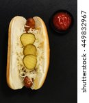 Small photo of Hot Dog with Sauerkraut and Pickles.