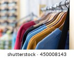 row of colorful apparel on... | Shutterstock . vector #450008143