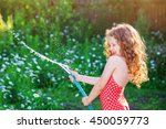 Laughing Little Girl Watering...