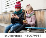 children sitting on bench and... | Shutterstock . vector #450079957