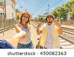 three friends at the station... | Shutterstock . vector #450082363