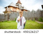 the boy plays with a sword | Shutterstock . vector #450126217