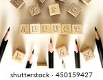 Small photo of ABDUCT word written on building block concept