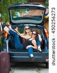 two girls posing in car.... | Shutterstock . vector #450256273