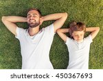 top view of cute little boy and ... | Shutterstock . vector #450367693