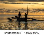 fishermen silhouettes at sunrise | Shutterstock . vector #450395047