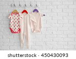 set of baby romper on brick wall | Shutterstock . vector #450430093