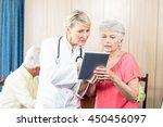 nurse talking to a senior woman ... | Shutterstock . vector #450456097