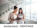 two business women discussing... | Shutterstock . vector #450474463