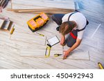 man laying laminate flooring in ... | Shutterstock . vector #450492943