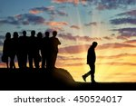 Small photo of Discrimination concept. Silhouettes of people crowd expel the man from their community.