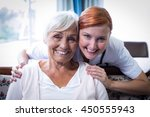 portrait of smiling doctor and... | Shutterstock . vector #450555943