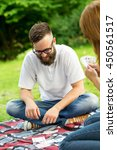 couple in love on a picnic in... | Shutterstock . vector #450561517