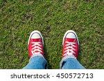 red sneaker on grass . top view | Shutterstock . vector #450572713