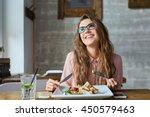 happy woman eating lunch in... | Shutterstock . vector #450579463