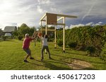 Small photo of Grandfather and grandson playing basketball on a makeshift village playground for basketball