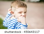 little boy in a striped t shirt ... | Shutterstock . vector #450643117