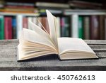 open book on a wooden table... | Shutterstock . vector #450762613