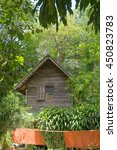 Small photo of home of monk in forest , yellow robe in front of home