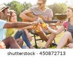 joyful friends relaxing in... | Shutterstock . vector #450872713