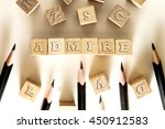Small photo of ADMIRE word written on building block concept